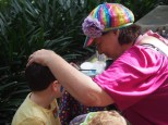 Helen from Rainbow Face Painting doing her magic
